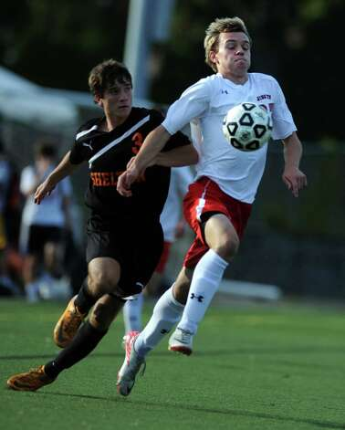 Fairfield Prep's Bryce Keblish controls the ball as Shelton's Craig Foley defends during their soccer match Wednesday, Sept. 19, 2012 at Alumni Field in Fairfield, Conn. Photo: Autumn Driscoll / Connecticut Post