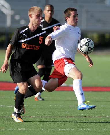 Fairfield Prep's Davie Bruton controls the ball as Shelton's Matthew Manzo defends during their soccer match Wednesday, Sept. 19, 2012 at Alumni Field in Fairfield, Conn. Photo: Autumn Driscoll / Connecticut Post