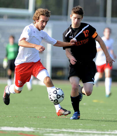 Fairfield Prep's Dave Bigley controls the ball as Shelton's Joseph Stein defends during their soccer match Wednesday, Sept. 19, 2012 at Alumni Field in Fairfield, Conn. Photo: Autumn Driscoll / Connecticut Post