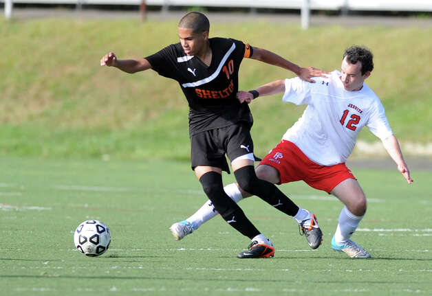 Shelton's Guitierres DeSouza controls the ball as Fairfield Prep's JC LeMeur defends during their soccer match Wednesday, Sept. 19, 2012 at Alumni Field in Fairfield, Conn. Photo: Autumn Driscoll / Connecticut Post