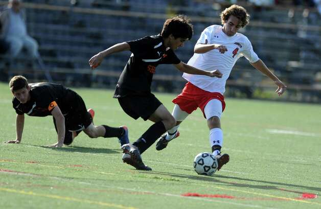Shelton's Austin Kothary and Fairfield Prep's Dave Bigley battle for the ball during their soccer match Wednesday, Sept. 19, 2012 at Alumni Field in Fairfield, Conn. Photo: Autumn Driscoll / Connecticut Post