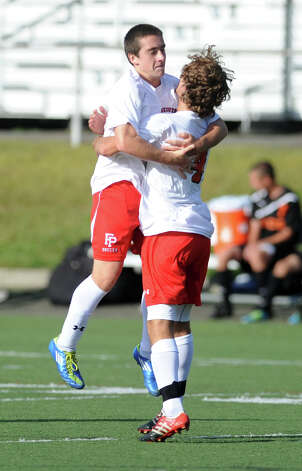Fairfield Prep's Davie Bruton celebrates his goal with teammate Dave Bigley during their soccer match against Shelton Wednesday, Sept. 19, 2012 at Alumni Field in Fairfield, Conn. Photo: Autumn Driscoll / Connecticut Post