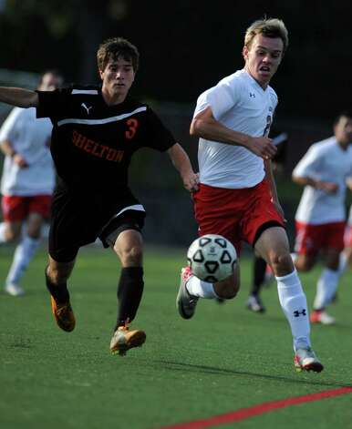 Fairfield Prep's Bryce Keblish and Shelton's Craig Foley chase down the ball during their soccer match Wednesday, Sept. 19, 2012 at Alumni Field in Fairfield, Conn. Photo: Autumn Driscoll / Connecticut Post