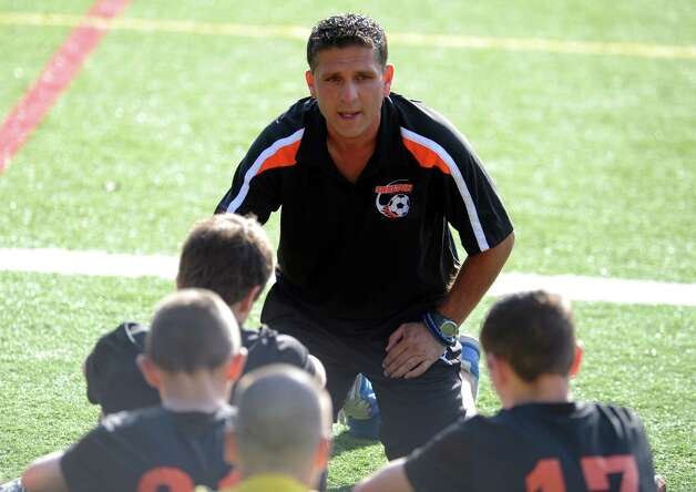 Shelton coach Joe D'Auria talks to his players during their soccer match against Fairfield Prep Wednesday, Sept. 19, 2012 at Alumni Field in Fairfield, Conn. Photo: Autumn Driscoll / Connecticut Post