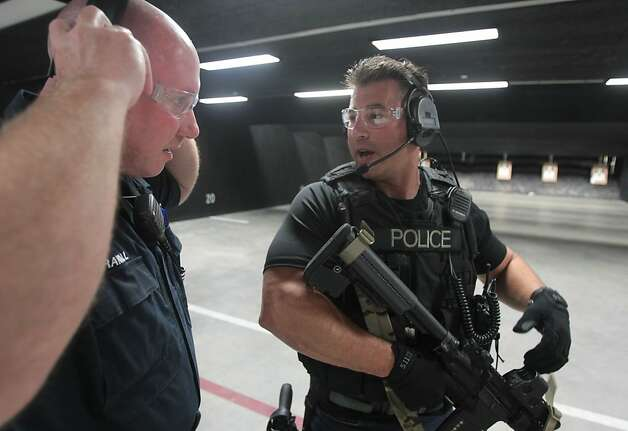 Fremont police Officer Todd Young (right) talks to Sgt. Gregg Crandall during target practice. Photo: Mathew Sumner, Special To The Chronicle