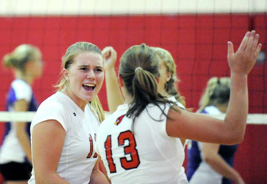 Greenwich players Ebba Mark, left, #11, and Heather Desino, # 13, celebrate during the girls high school volleyball match between Greenwich High School and Westhill High School at Greenwich High School, Wednesday afternoon, Sept. 19, 2012. Photo: Bob Luckey / Greenwich Time