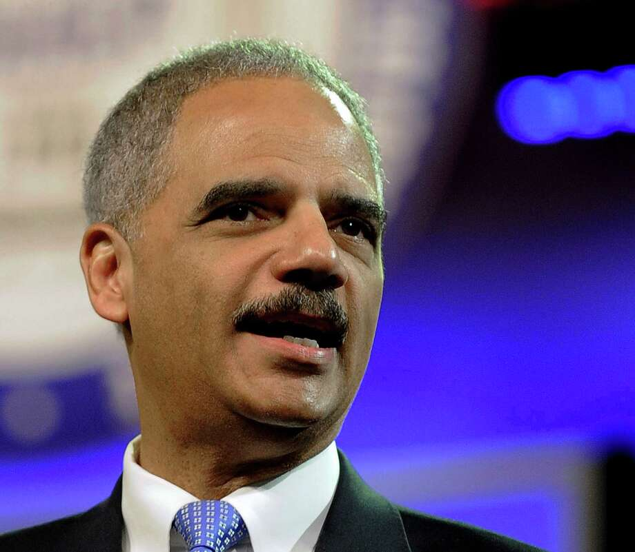 Attorney General Eric Holder was cleared by the agency's report. Photo: Pat Sullivan / AP