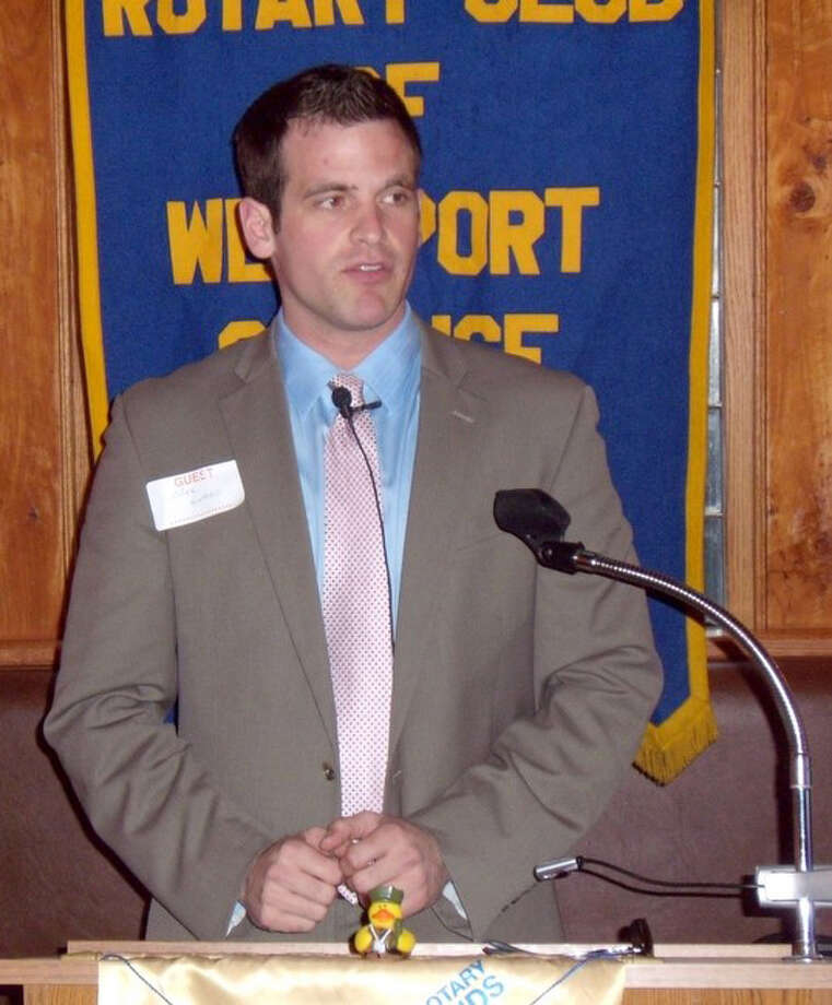 Mike Evans, a Weston boys basketball alumnus, speaks at the Westport Sunrise Rotary about his experience of playing professional basketball in Ireland and using basketball as a tool to unite people from different backgrounds. Photo: ST