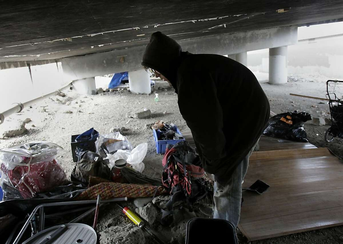 A homeless man named Jonathan Manley sorted through his belongings under the highway. He says he has no where else to go despite the continual police presence. A persistent homeless encampment at the highway 280 onramp at King Street in San Francisco, Calif. was the scene of a fire Wednesday September 19, 2012. This is the same location where state and local authorities cleared out a large homeless camp several weeks ago.