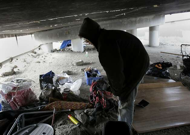 A homeless man named Jonathan Manley sorted through his belongings under the highway. He says he has no where else to go despite the continual police presence. A persistent homeless encampment at the highway 280 onramp at King Street in San Francisco, Calif. was the scene of a fire Wednesday September 19, 2012.  This is the same location where state and local authorities cleared out a large homeless camp several weeks ago. Photo: Brant Ward, The Chronicle