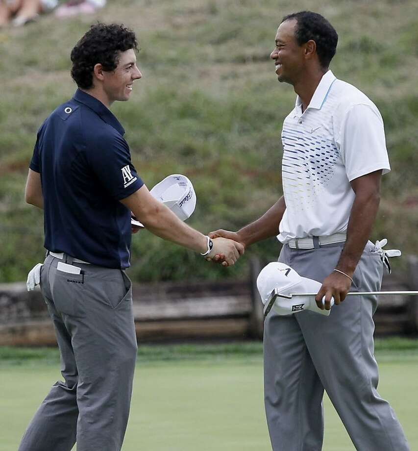 "Rory McIlroy (left) laughed off Greg Norman's comments. McIlroy: ""How can I intimidate Tiger Woods?"" Photo: Charles Rex Arbogast, Associated Press"