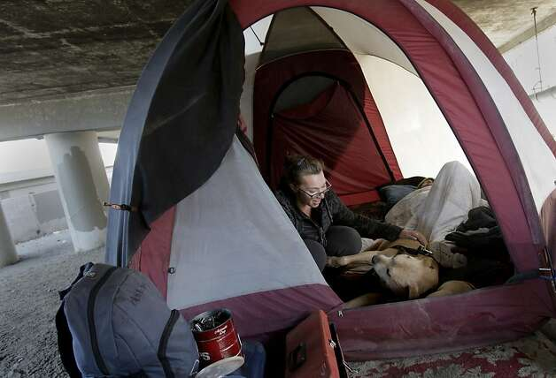 Jessica and Buddy live beneath the Interstate 280 on-ramp despite efforts to clear the area. Photo: Brant Ward, The Chronicle