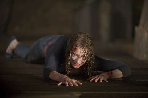 "Kristen Connolly plays a guest who regrets her visit to ""The Cabin in the Woods"" in Drew Goddard's effective horror satire. Photo: Diyah Pera, Associated Press"