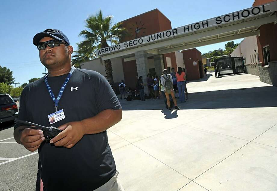 Campus supervisor Jerome Castaneda monitors the Arroyo Seco Junior High parking lot in Santa Clarita. Photo: Jonathan Pobre, Associated Press