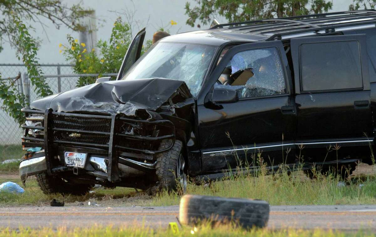 A vehicle involved in an accident litters the access road to Interstate 35 South near Shepherd Road on Wednesday, Sept. 19, 2012.