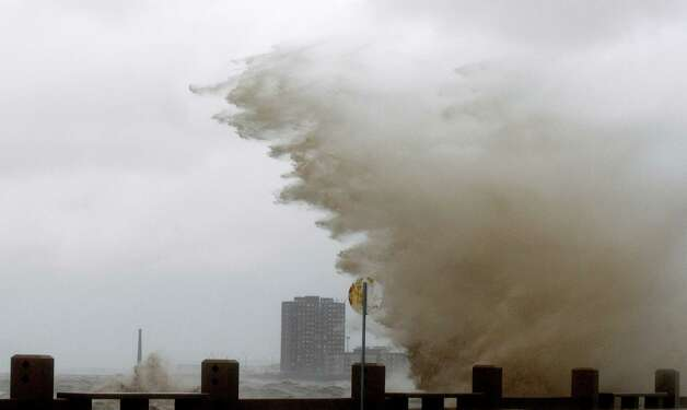 High waves from Rio de la Plata River crash over the sea wall on to an avenue during a heavy wind storm in Montevideo, Uruguay, Wednesday, Sept. 19, 2012. A powerful storm blew across the southern cone of South America, breaking windows in several buildings in Uruguay's capital, toppling about a hundred trees and cutting off three highways due to flooding. Photo: Matilde Campodonico, Associated Press / AP
