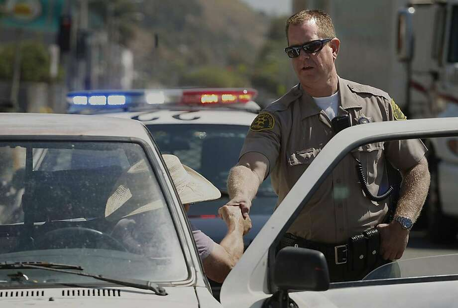 A driver thanks David Huelsen, a traffic detective for the Los Angeles County Sheriff's Department, after a traffic stop. Photo: Gary Friedman, McClatchy-Tribune News Service