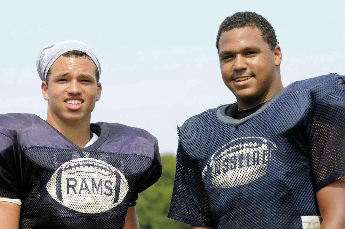 Rensselaer High School football players Brandon Butler, left, and Seth Butler during a scrimmage with Albany Academy in Albany, NY Saturday Aug. 25, 2012. (Michael P. Farrell/Times Union)