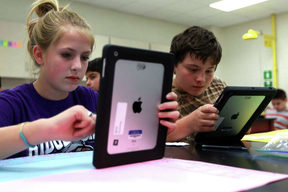 10. Missouri -- 2.1 percent growth in technology jobsIn this photo, Makenzie Middaugh, 13, left, and Zerik Rodriguez, 13, work on classifying stars based on temperature and brightness using an iPad during an eighth grade science class at Baines Middle School Wednesday, Sept. 19, 2012, in Missouri City. Photo: Johnny Hanson, Houston Chronicle / © 2012  Houston Chronicle