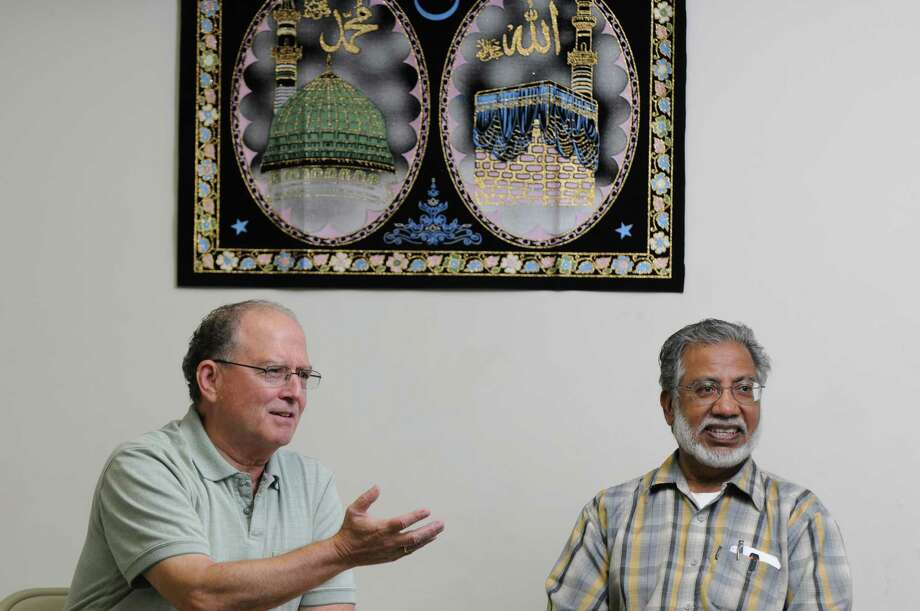 Stephen Downs, left, and Shamshad Ahmad, right, talk about a recent incident when they were interrogated by Albany Police after someone called police about their conversation with two other men, while eating pizza, which they felt was a case of profiling, on Monday Sept. 17, 2012 in Albany, NY.  They spoke about the case at the Masjid As-Salam Mosque, in Albany. (Philip Kamrass / Times Union) Photo: Philip Kamrass / 00019280A