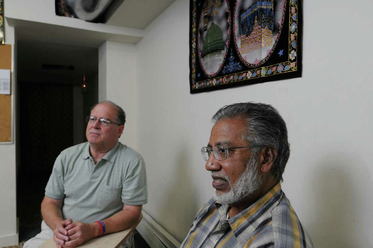 Stephen Downs, left, and Shamshad Ahmad, right, talk about a recent incident when they were interrogated by Albany Police after someone called police about their conversation with two other men, while eating pizza, which they felt was a case of profiling, on Monday Sept. 17, 2012 in Albany, NY. They spoke about the case at the Masjid As-Salam Mosque, in Albany. (Philip Kamrass / Times Union)