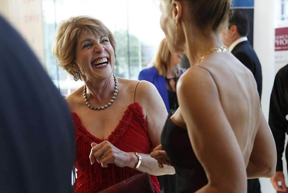 Dagmar Dolby (left) laughs with a friend inside Davies Symphony Hall in San francisco Calif. as they celebrate at the San Francisco Symphony's Opening Gala on Wednesday, Sept. 19, 2012. Photo: Alex Washburn, Special To The Chronicle