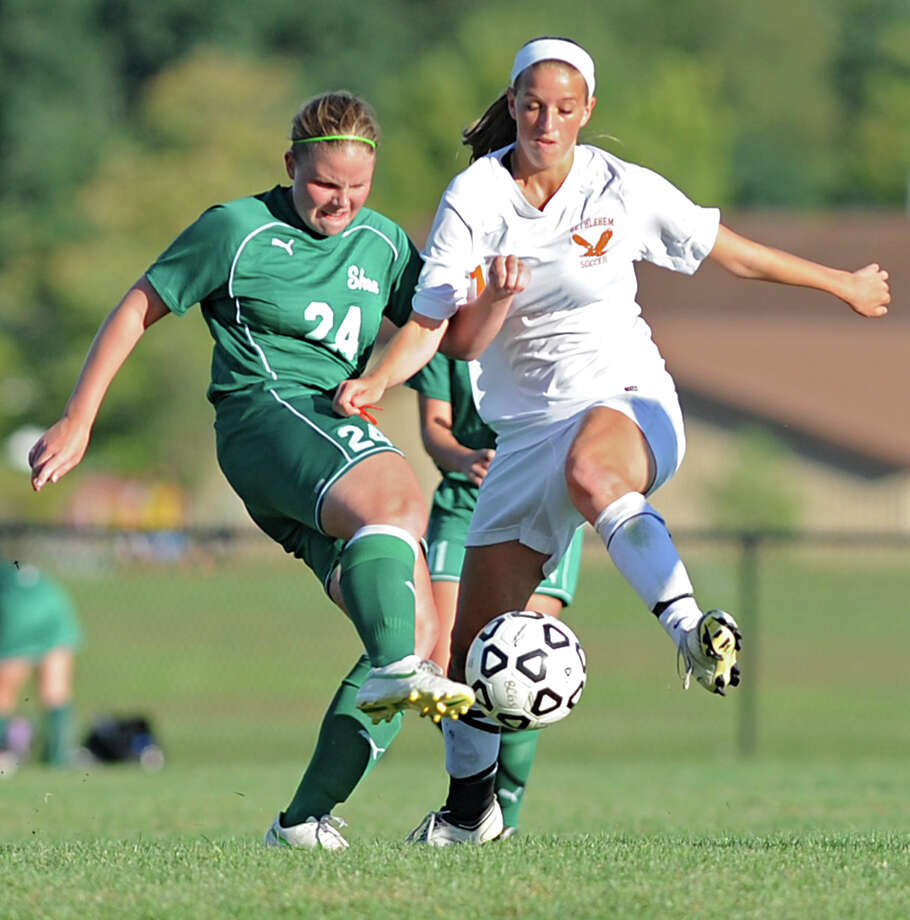 From left, Shenendehowa's Molly Costello and Bethlehem's Tara Teal battle for the ball during a soccer game Wednesday, Sept. 19, 2012 in Delmar, N.Y. (Lori Van Buren / Times Union) Photo: Lori Van Buren