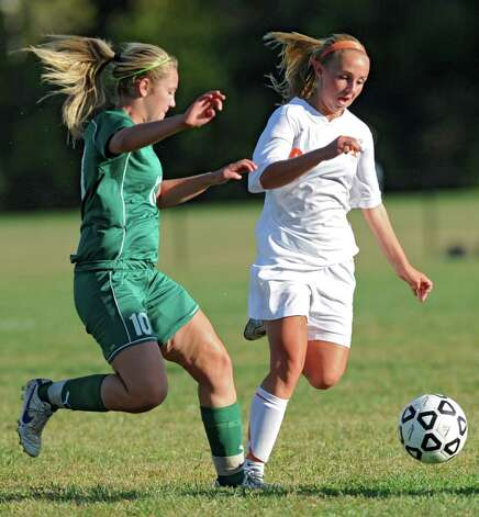 From left, Shenendehowa's Paige Byrne tries to get the ball from Bethlehem's Lindsey Woller during a soccer game Wednesday, Sept. 19, 2012 in Delmar, N.Y. (Lori Van Buren / Times Union) Photo: Lori Van Buren