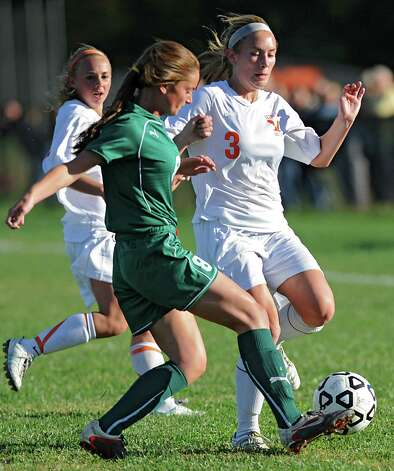 From left, Shenendehowa's Kaitlyn Curly battles for the ball with Bethlehem's Elle Lutz during a soccer game Wednesday, Sept. 19, 2012 in Delmar, N.Y. (Lori Van Buren / Times Union) Photo: Lori Van Buren