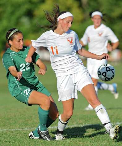 From left, Shenendehowa's Sara NasserElgrgawi tries to get the ball from Bethlehem's Tara Teal during a soccer game Wednesday, Sept. 19, 2012 in Delmar, N.Y. (Lori Van Buren / Times Union) Photo: Lori Van Buren