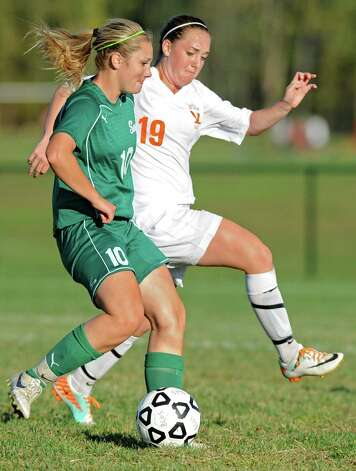 From left, Shenendehowa's Paige Byrne and Bethlehem's Autumn Fetterolf battle for the ball during a soccer game Wednesday, Sept. 19, 2012 in Delmar, N.Y. (Lori Van Buren / Times Union) Photo: Lori Van Buren