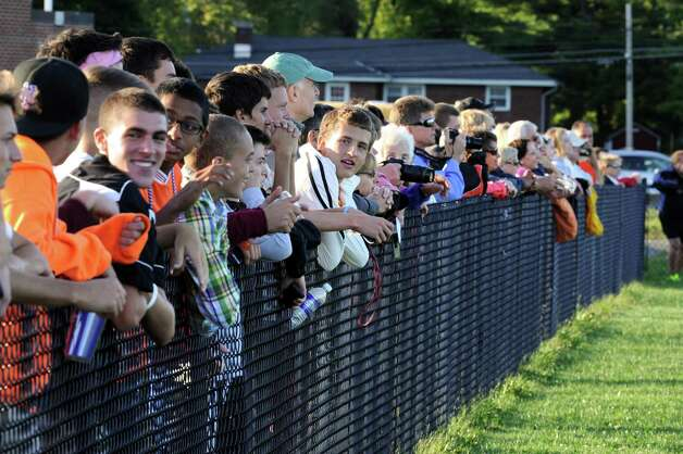Fans line the fence to watch a girl's soccer game between Bethlehem and Shenendehowa Wednesday, Sept. 19, 2012 in Delmar, N.Y. (Lori Van Buren / Times Union) Photo: Lori Van Buren