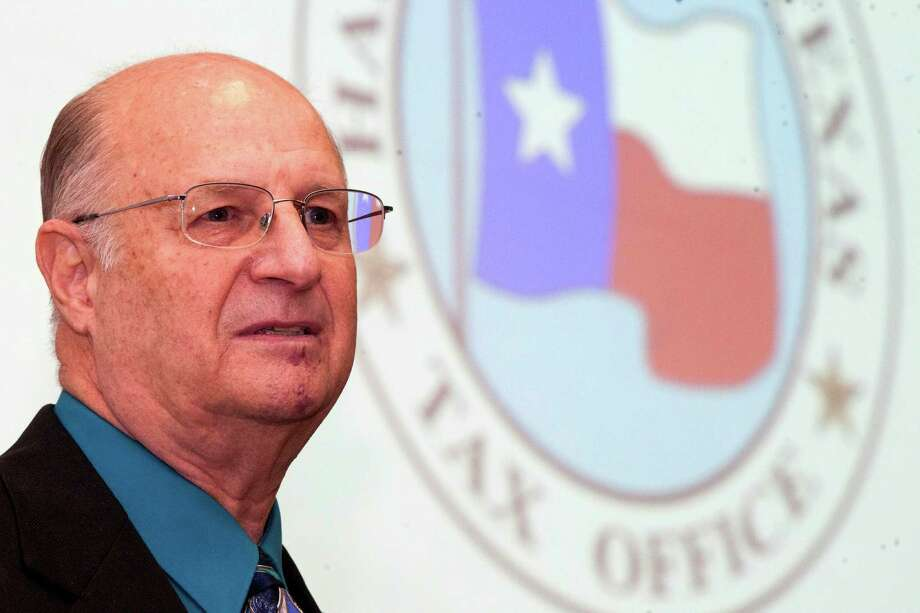 County tax assessor-collector and voter registrar Don Sumners talks to the media at the county administration building on Wednesday. Photo: J. Patric Schneider / © 2012 Houston Chronicle