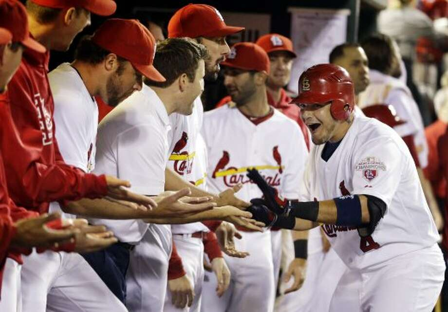 Sept. 19: Cardinals 5, Astros 0Yadier Molina, right, is congratulated by teammates in the dugout after his 20th home run of the year. (Jeff Roberson / Associated Press)