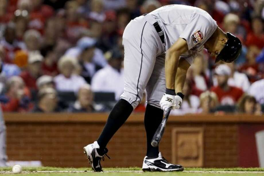 Justin Maxwell bends over in pain after being hit by a foul tip during the fourth inning. (Jeff Roberson / Associated Press)