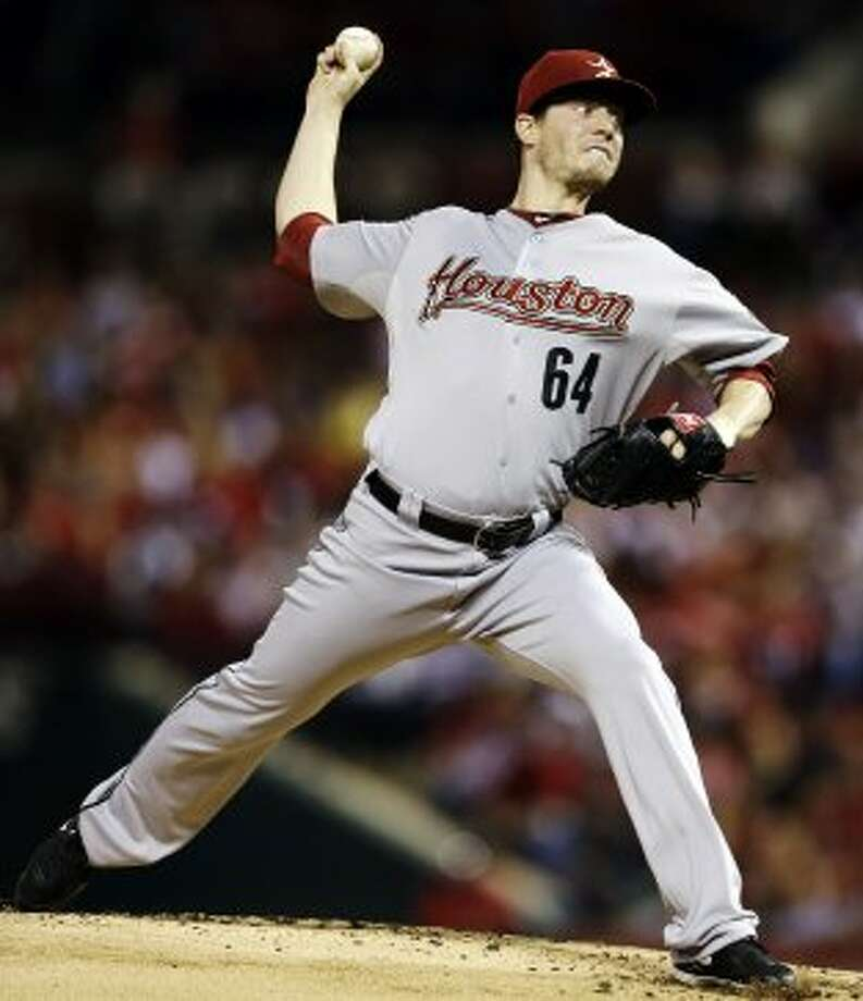 Astros starting pitcher Lucas Harrell throws during the first inning. (Jeff Roberson / Associated Press)