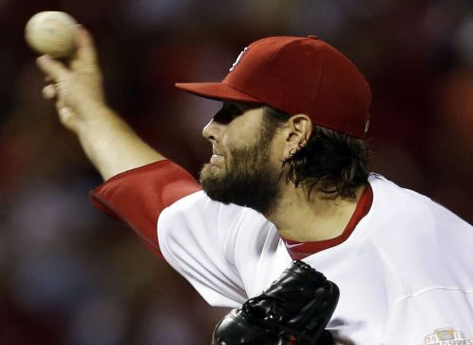 Lance Lynn throws during the seventh inning of the game. (Jeff Roberson / Associated Press)