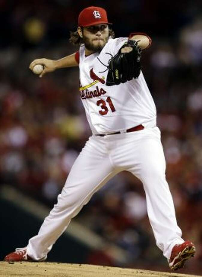 Lance Lynn throws during the first inning. (Jeff Roberson / Associated Press)