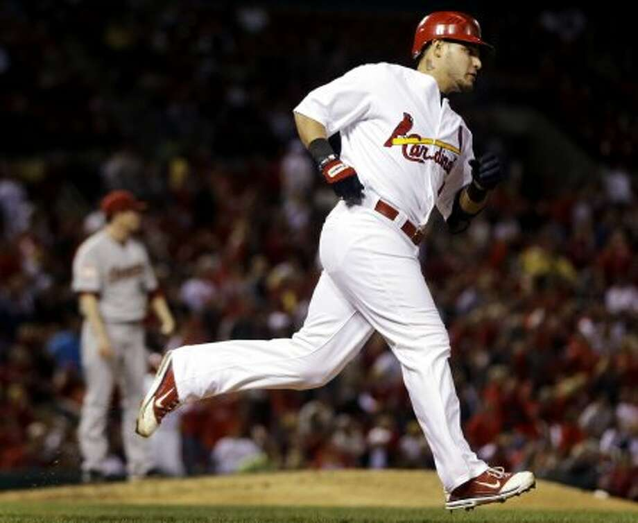 Yadier Molina rounds the bases after hitting a solo home run. (Jeff Roberson / Associated Press)