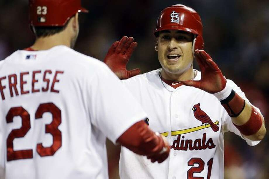 David Freese, left, is congratulated by Allen Craig after hitting a two-run home run. (Jeff Roberson / Associated Press)