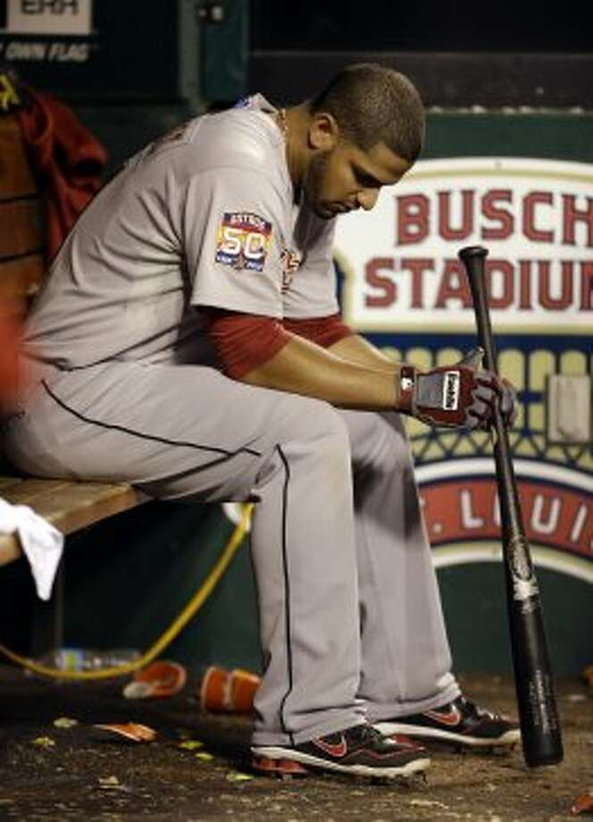 Fernando Martinez sits in the dugout during the eighth inning. of a baseball game, Tuesday, Sept. 18, 2012, in St. Louis. The Cardinals won 4-1. (AP Photo/Jeff Roberson) (Jeff Roberson / Associated Press)