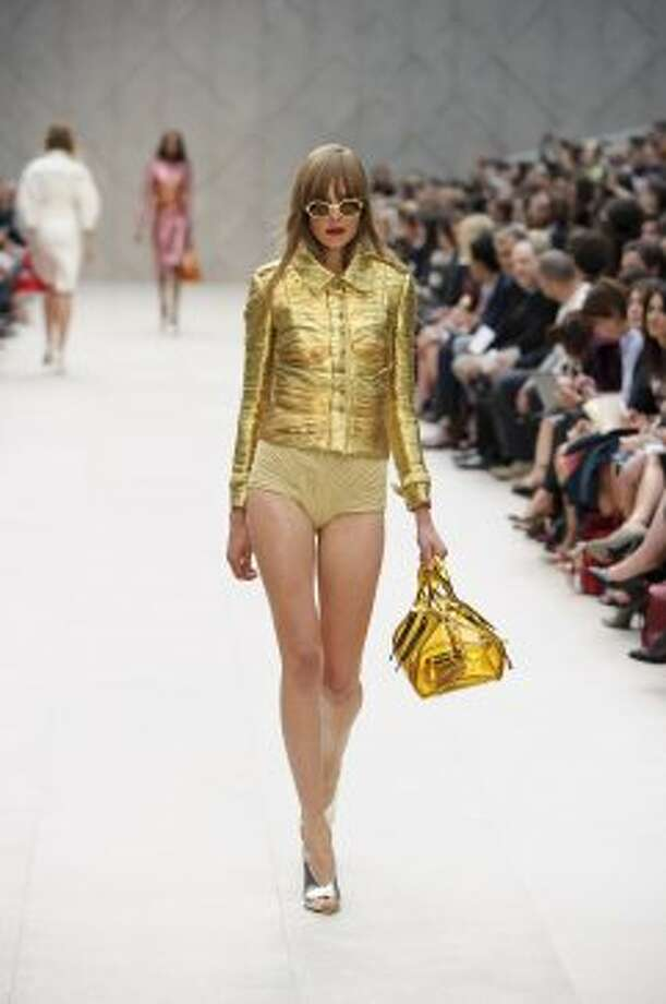 A model wears a design by Burberry Prorsum. (ASSOCIATED PRESS)