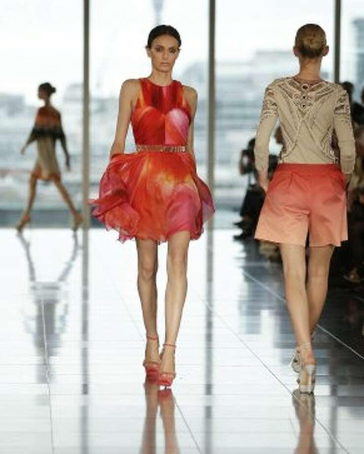 Models wear creations by Matthew Williamson. (ASSOCIATED PRESS)