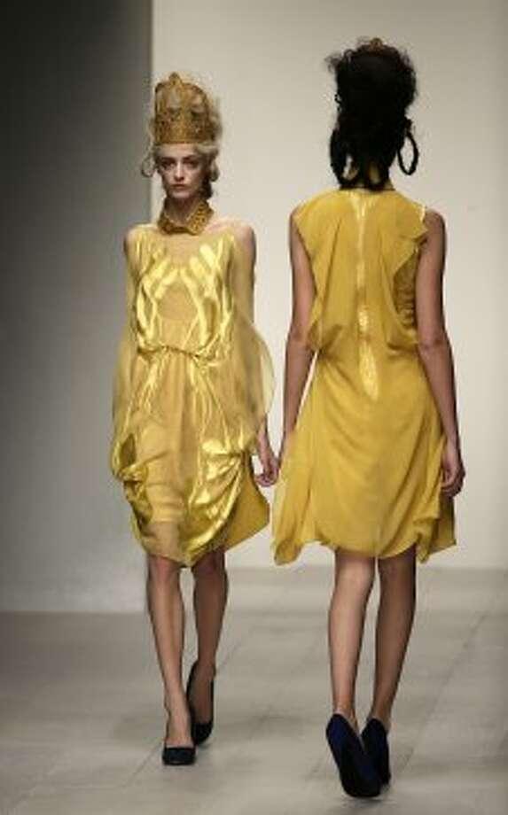 A model presents a design by Bora Aksu. (ASSOCIATED PRESS)