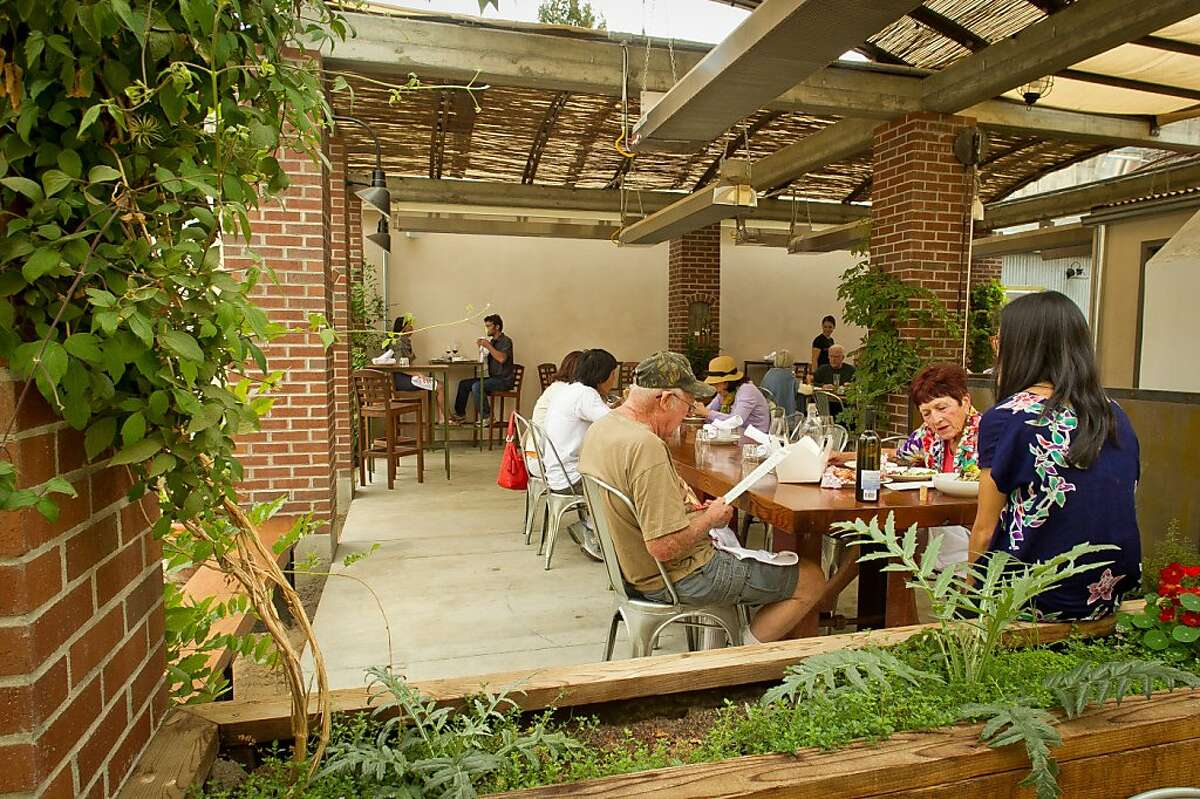 Diners enjoy lunch on the patio at Campo Fina restaurant in Healdsburg, Calif., on Wednesday, September 6th, 2012.