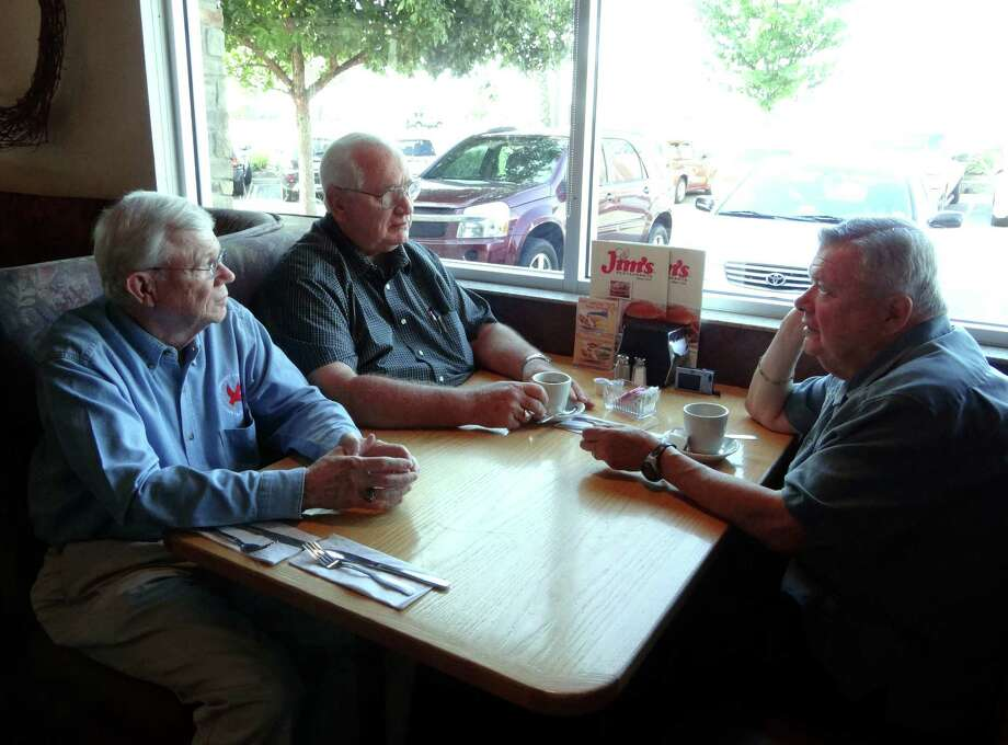Joe Hayes (from left), Ed Courtney and Marty Sablik, credited with founding the popular Catholic retreat program ACTS, visit at a Jim's Restaurant as they did a quarter-century ago. Photo: Billy Calzada, San Antonio Express-News / © San Antonio Express-News