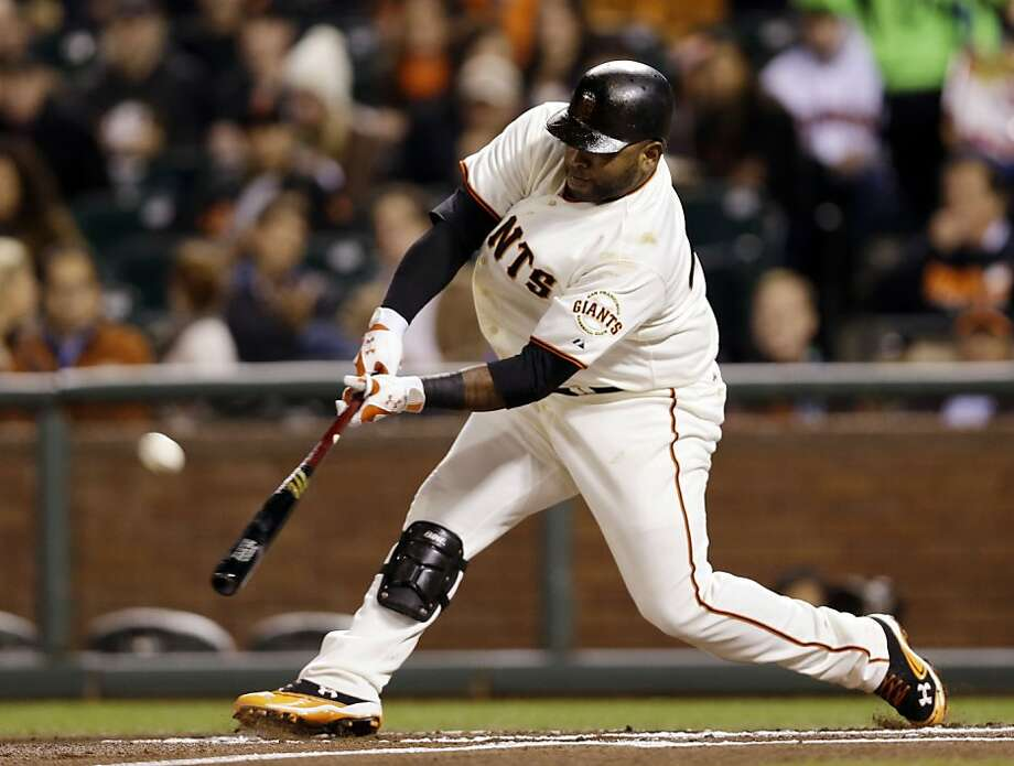 San Francisco Giants' Pablo Sandoval hits a three-run home run against the Colorado Rockies during the first inning of a baseball game on Wednesday, Sept. 19, 2012, in San Francisco. (AP Photo/Marcio Jose Sanchez) Photo: Marcio Jose Sanchez, Associated Press