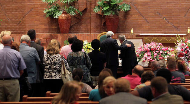 Visitors pay respects to the family at a viewing and rosary for Kali Gorzell is held at the St. Mark the Evangelist Catholic Church on July 25, 2012. Photo: Tom Reel, San Antonio Express-News / ©2012 San Antono Express-News