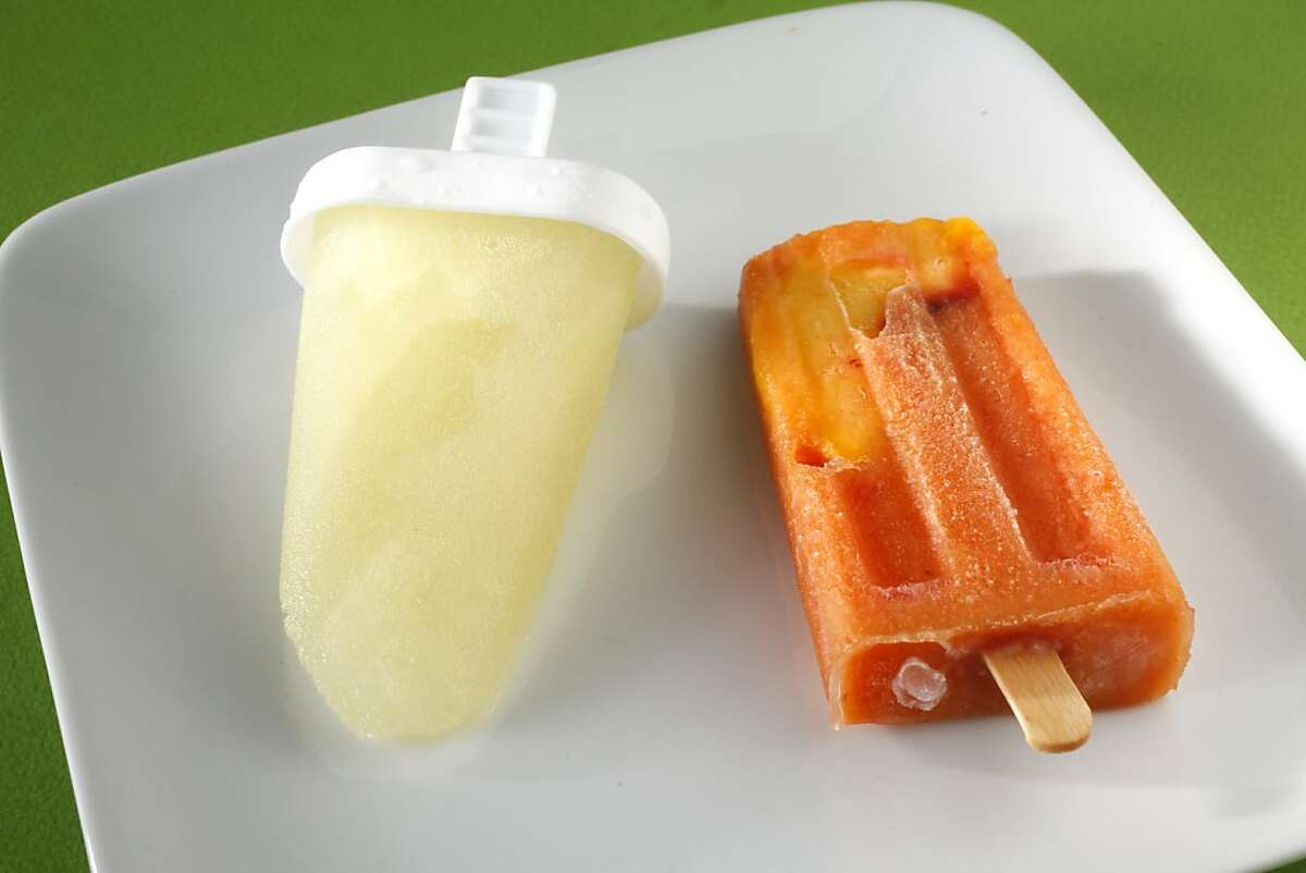 Mojito popsicle (left) and Peach Bourbon popsicle (right) as seen in San Francisco, California, on Wednesday, September 19, 2012. Food styled by Lauren N Reuthinger.
