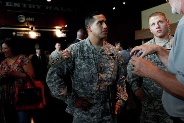 Wounded Warriors Sgt. First Class Raymond Soto, left, and Sgt. Cody Winstead, right, listen to Gary Pitts, far right, an instructor/mentor with VAS Veteran Adjusting School for insurance adjusting, during the RecruitMilitary Veteran job fair at the AT&T Center in San Antonio on Thursday, Sept. 13, 2012. Winstead was injured in Afghanistan in 2012 and Soto was inured in Afghanistan in 2003. Photo: Lisa Krantz, San Antonio Express-News / San Antonio Express-News